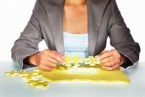 Woman Assembling Puzzle